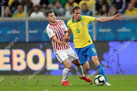 Paraguayan Richard Ortiz (L) vies for the ball with Brazilian Filipe Luis (R) during the Copa America 2019 quarter-finals soccer match between Brazil and Paraguay at Arena do Gremio Stadium in Porto Alegre, Brazil, 27 June 2019.