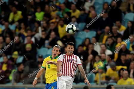 Brazilian Filipe Luis (L) vies for the ball with Paraguayan Hernan Perez (R) during the Copa America 2019 quarter-finals soccer match between Brazil and Paraguay at Arena do Gremio Stadium in Porto Alegre, Brazil, 27 June 2019.