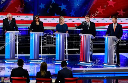 Democratic presidential candidate former Colorado Sen. Michael Bennet, second from right, speaks during the Democratic primary debate hosted by NBC News at the Adrienne Arsht Center for the Performing Art, in Miami, as from left, Sen. Bernie Sanders, I-Vt., Sen. Kamala Harris, D-Calif., Sen. Kirsten Gillibrand, D-N.Y., and Rep. Eric Swalwell, D-Calif., listen