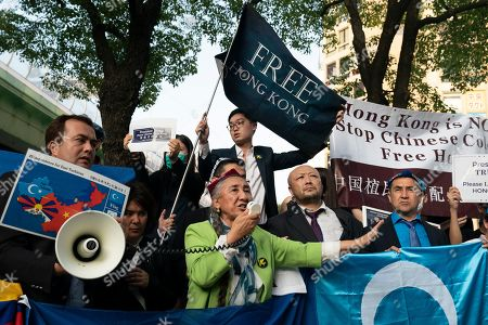 Uyghur human rights activist Rebiya Kadeer, center, speaks during a rally against the Chinese government, in Osaka, Japan. Osaka is hosting the G-20 Summit