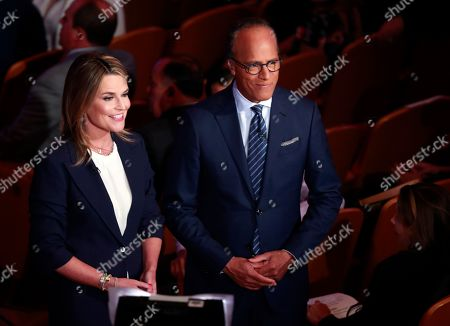 Stock Image of Lester Holt, NBC Anchor and Savannah Guthrier, NBC Co-Anchor, wait for the start of the Democratic primary debate hosted by NBC News at the Adrienne Arsht Center for the Performing Art, in Miami
