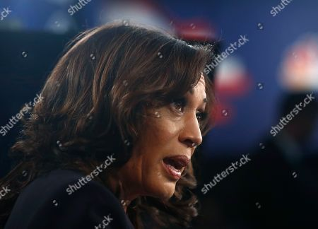 Democratic presidential candidate Sen. Kamala Harris, D-Calif., listens to questions after the Democratic primary debate hosted by NBC News at the Adrienne Arsht Center for the Performing Art, in Miami