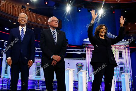 Democratic presidential candidates former vice president Joe Biden, left, Sen. Bernie Sanders, I-Vt., and Sen. Kamala Harris, D-Calif., right, stand on stage for a photo op before the start of the the Democratic primary debate hosted by NBC News at the Adrienne Arsht Center for the Performing Arts, in Miami