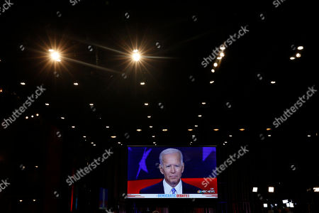 Democratic presidential candidates former vice president Joe Biden, speaks on a television during the Democratic primary debate hosted by NBC News at the Adrienne Arsht Center for the Performing Arts, in Miami