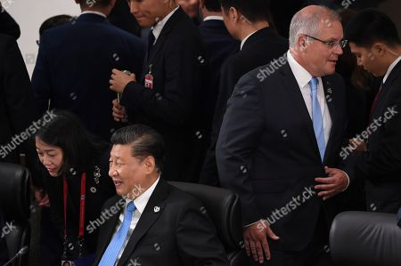 Australian Prime Minister Scott Morrison (R) walks past Chinese President Xi Jingping (L) during a Plenary Session on the first day of the G20 summit in Osaka, Japan, 28 June 2019. It is the first time Japan hosts a G20 summit. The summit gathers leaders from 19 countries and the European Union to discuss topics such as global economy, trade and investment, innovation and employment.