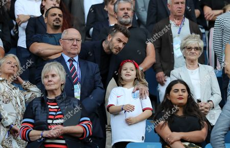 David Beckham with his daughter Harper Beckham watch from the stands