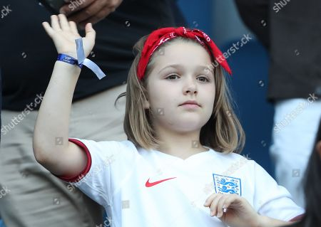 Harper Beckham  wearing England football Shirt  waves to the Players.