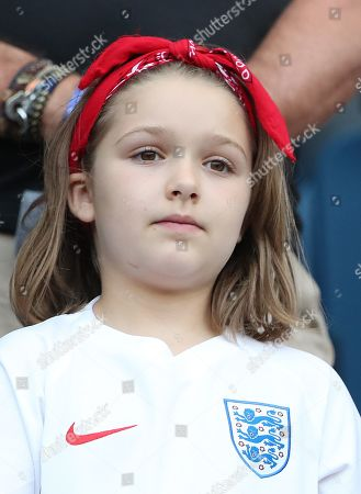 Harper Beckham  wearing England Football Shirt watches  from the stands