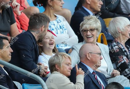 David Beckham and his mother Sandra right with Harper Beckham all smiles during victory