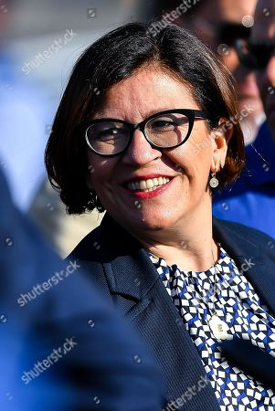 Italian Minister of Defence Elisabetta Trenta attends the Morandi highway bridge's pillars demolition, in Genoa, northern Italy, 28 June 2019. Thousands of people were evacuated ahead of the demolition works, which started on the day. Experts have blown up the remains of the bridge which partially collapsed on 14 August 2018 killing 43 people. A new viaduct replacing the Morandi bridge is expected to be completed by 2020.