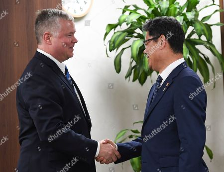 US Special Representative to North Korea Stephen Biegun (L) shakes hands with South Korean unification minister Kim Yeon-chul (R) prior their meeting at the Ministry of Unification in Seoul, South Korea, 28 June 2019. Biegun arrived in Seoul ahead of US President Donald J. Trump's trip to South Korea.