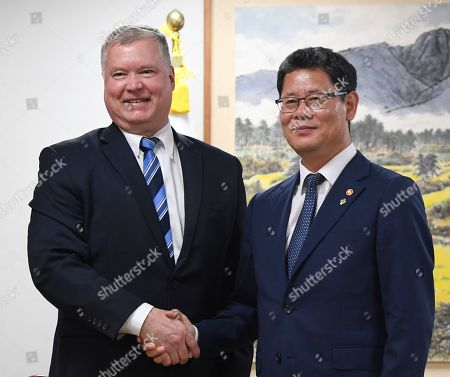 US Special Representative to North Korea Stephen Biegun (L) and South Korean unification minister Kim Yeon-chul (R) pose for photo prior their meeting at the Ministry of Unification in Seoul, South Korea, 28 June 2019. Biegun arrived in Seoul ahead of US President Donald J. Trump's trip to South Korea.