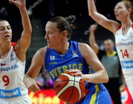 Elin Eldebrink (C) of Sweden in action against Lenka Bartakova (L) of Czech Republic during the FIBA Women's Eurobasket 2019 match between Czech Republic and Sweden in Riga, Latvia, 28 June 2019.