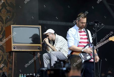 Dan Smith, Will Farquarson. Dan Smith, left, and Will Farquarson of Bastille perform at the Pyramid Stage on the third day of the Glastonbury Festival at Worthy Farm, Somerset, England