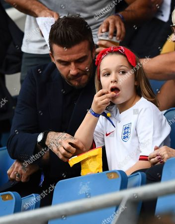 Harper Beckham eats M&M's with her father David