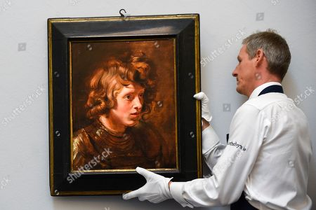 "A technician hangs ""Head of a Young Warrior"", 1615-17, by Peter Paul Reubens (Est. GBP2.5-3.5m) at the preview of Sotheby's Old Masters sale which takes place at its New Bond Street galleries on 3 July."