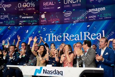 Stock Image of Julie Wainwright, center, CEO of The RealReal, celebrates her company's IPO at the Nasdaq opening bell, in New York. The online reseller of luxury brand clothing and accessories is based in San Francisco