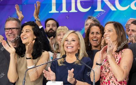 Julie Wainwright, center, CEO of The RealReal, celebrates her company's IPO at the Nasdaq opening bell, in New York. The online reseller of luxury brand clothing and accessories is based in San Francisco. With her are Rati Levesque, left, Chief Operating Officer, and Adena Friedman, right, President and CEO of Nasdaq