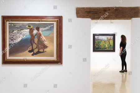 View of the artwork 'To the Water' (L), by Spanish artist Joaquin Sorolla, during the exhibition 'From Sorolla to Picasso and Valdes' at Espacio Carmen Thyssen art gallery' in Sant Feliu de Guixols, Catalonia, northeastern Spain, 28 June 2019. The exhibition, running from 29 June to 30 October 2019, features 46 artworks by 21 authors, belonged to Fundació Bancaixa Foundation and Carmen Thyssen Collections, from the end of the 19th century to 2005.