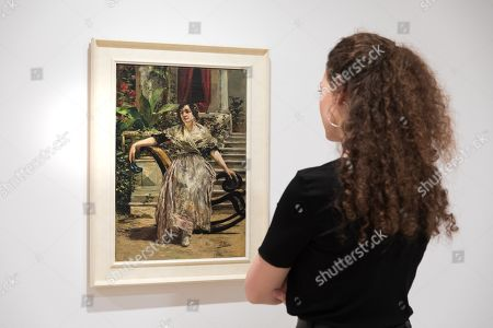 A woman observes the painting 'Valenciana' by artist Ignacio Pinazo, during the presentation of the exhibition 'From Sorolla to Picasso and Valdes' at Espacio Carmen Thyssen art gallery' in Sant Feliu de Guixols, Catalonia, northeastern Spain, 28 June 2019. The exhibition, running from 29 June to 30 October 2019, features 46 artworks by 21 authors, belonged to Fundació Bancaixa Foundation and Carmen Thyssen Collections, from the end of the 19th century to 2005.