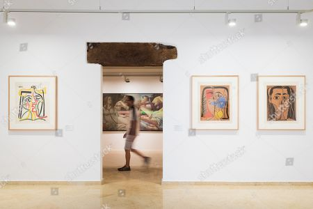 A man walks past next to several artworks during the presentation of the exhibition 'From Sorolla to Picasso and Valdes' at Espacio Carmen Thyssen art gallery' in Sant Feliu de Guixols, Catalonia, northeastern Spain, 28 June 2019. The exhibition, running from 29 June to 30 October 2019, features 46 artworks by 21 authors, belonged to Fundació Bancaixa Foundation and Carmen Thyssen Collections, from the end of the 19th century to 2005.