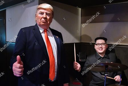 Dennis Alan, impersonator of U.S. President Donald Trump and Howard X, impersonator of North Korean leader Kim Jong-un perform at Comodo Jazz Bar in Osaka, Japan