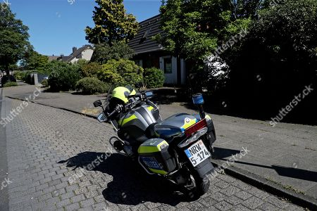 police motorcycle front house man suspected posession Editorial