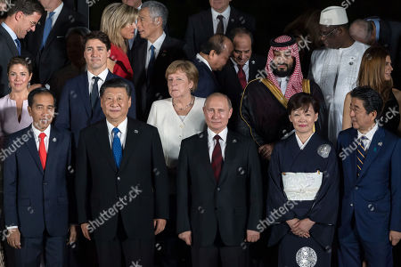 I ndonesia's President Joko Widodo, Canada's Prime Minister Jtin Trudeau's wife Sophie Gregoire, China's President Xi Jinping, Germany's Chancellor Angela Merkel, Rsia's President Vladimir Putin, Saudi Arabia's Crown Prince Mohammad bin Salman bin Abdulaziz Al Saud, Japan's Prime Minister Shinzo Abe's wife Akie Abe and Japan's Prime Minister Shinzo Abe.