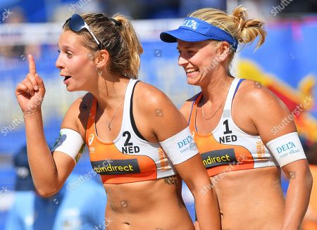 Stock Photo of Dutch players Joy Stubbe (L) and Marleen van Iersel (R) celebrate after defeating Kerri Walsh Jennings and Brooke Sweat of the USA during the Beach Volleyball World Championships in Hamburg, Germany, 28 June 2019.