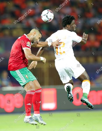 Morocco's Mehdi Amine (L) in action aganist Ivory Coast's Wilfried Bony (R) during the 2019 Africa Cup of Nations (AFCON) group D soccer match between Morocco and the Ivory Coast at Salam Stadium in Cairo, Egypt, 28 June 2019.