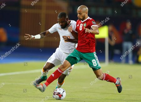 Ivory Coast's Die Serey, left, and Morocco's Karim El Ahmadi Aroussi fight for the ball during the African Cup of Nations group D soccer match between Morocco and Ivory Coast in Al Salam Stadium in Cairo, Egypt