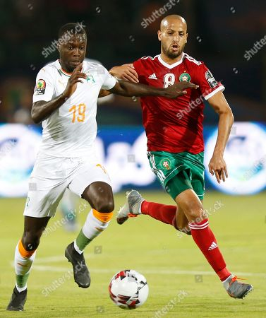 Ivory Coast's Nicolas Pepe, left, in action in front of Morocco's Karim El Ahmadi Aroussi during the African Cup of Nations group D soccer match between Morocco and Ivory Coast in Al Salam Stadium in Cairo, Egypt