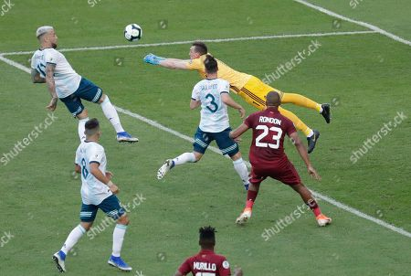 Argentina's goalkeeper Franco Armani, right, blocks a shot during a Copa America quarterfinal soccer match against Venezuela at the Maracana stadium in Rio de Janeiro, Brazil