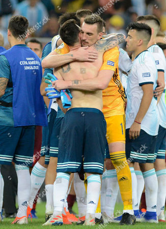 Argentina's goalkeeper Franco Armani embraces Lionel Messi at the end of a during a Copa America quarterfinal soccer match against Venezuela at the Maracana stadium in Rio de Janeiro, Brazil