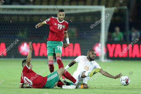 Ivory Coast's Die Serey, bottom right, is tackled by Morocco's Younes Belhanda during the African Cup of Nations group D soccer match between Morocco and Ivory Coast in Al Salam Stadium in Cairo, Egypt