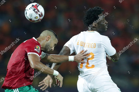 Ivory Coast's Wilfried Bony, right, heads the ball past Morocco's Mehdi Amine El Mouttaqui during the African Cup of Nations group D soccer match between Morocco and Ivory Coast in Al Salam Stadium in Cairo, Egypt
