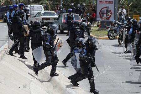 Honduran security forces prevent an act commemorating the tenth anniversary of the coup against the then president of the country, Manuel Zelaya, when he promoted constitutional reforms that the law did not allow, in Tegucigalpa, Honduras, 28 June 2019. LIBRE, created three years after the coup and whose general coordinator is Zelaya himself, had planned a commemorative event on a boulevard in front of the southern end of Toncontin International Airport, whose accesses were closed and under strict security measures, to avoid eventual violent demonstrations, according to the authorities.