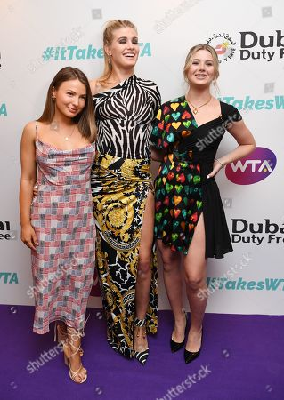 (L-R) Mimi Bouchard, Eugenie Bouchard and Charlotte Bouchard arrive at the Dubai Duty Free WTA Summer Party 2019 held at the Jumeirah Carlton Tower in London, Britain, 28 June 2019.