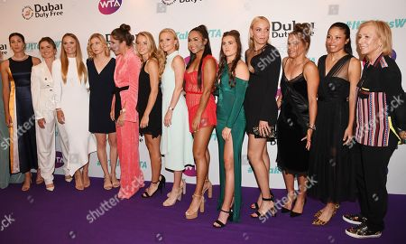 (L-R) Athletes Garbine Muguruza, Elina Svitolina, Caroline Wozniacki, Julia Boserup, Johanna Konta, Katie Swan, Harriet Dart, Heather Watson, Katy Dunne, Donna Vekic, Barbora Strycova, an unidentified woman and Martina Navratiolova pose at the Dubai Duty Free WTA Summer Party 2019 held at the Jumeirah Carlton Tower in London, Britain, 28 June 2019.