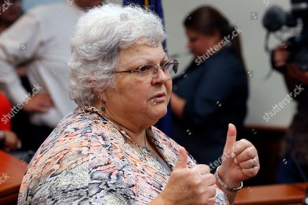 Susan Bro, mother of Heather Heyer who was killed in 2017 during a white supremacist rally, gives a thumbs up to the press after the sentencing of James Alex Fields Jr. in federal court in Charlottesville, Va., . Fields was sentenced to life in prison for his role in a car attack during a white supremacist rally in 2017. Bro gave a thumbs up to the press for their coverage of the tragedy