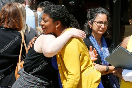Victims of the 2017 car attack by James Alex Fields Jr., hug outside court after his sentencing in Charlottesville, Va., . Fields was sentenced to life in prison for his role in a car attack during a white supremacist rally in 2017