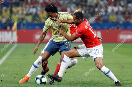 Colombia's Juan Guillermo Cuadrado (L) vies for the ball against Chile's Jean Beausejour (R) during the Copa America 2019 quarter-finals soccer match between Colombia and Chile at Arena Corinthians in Sao Paulo, Brazil, 28 June 2019.
