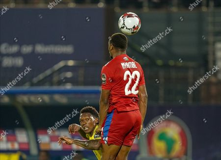 Ryan Nyambe of Namibia heading the ball in front of Lebo Mothiba of South Africa during the African Cup of Nations match between South Africa and Namibia at the Al Salam Stadium in Cairo, Egypt