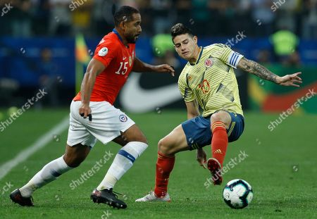Stock Image of Chile's Jean Beausejour, right, and Colombia's James Rodriguez, battle for the ball during a Copa America quarterfinal soccer match at the Arena Corinthians in Sao Paulo, Brazil