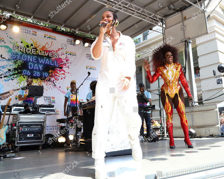 Stock Photo of Alicia Keys, Bob the Drag Queen. Alicia Keys, left, and Bob the Drag Queen participate in the second annual Stonewall Day honoring the 50th anniversary of the Stonewall riots, hosted by Pride Live and iHeartMedia, in Greenwich Village, in New York