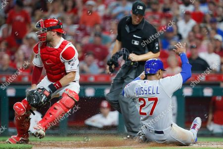 Chicago Cubs' Addison Russell (27) scores on an RBI sacrifice fly by Albert Almora Jr. off Cincinnati Reds relief pitcher David Hernandez in the seventh inning of a baseball game, in Cincinnati