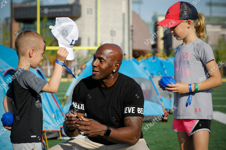 Green Bay Packers all-time leading receiver Donald Driver talks with attendees of Northwestern Mutual's Ultimate Campout Fighting Childhood Cancer at the Green Bay Packer's Titletown development on in Green Bay, Wis. before signing autographs for them