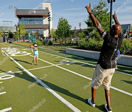 Green Bay Packers all-time leading receiver Donald Driver celebrates with an attendee of Northwestern Mutual's Ultimate Campout Fighting Childhood Cancer at the Green Bay Packer's Titletown development on in Green Bay, Wis
