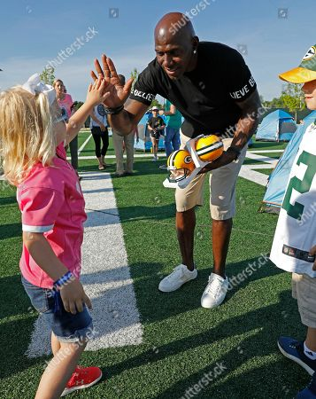 Green Bay Packers all-time leading receiver Donald Driver high fives attendees of Northwestern Mutual's Ultimate Campout Fighting Childhood Cancer at the Green Bay Packer's Titletown development on in Green Bay, Wis