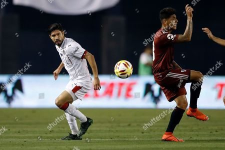 Chivas forward Oribe Peralta, left, looks at the ball near River Plate midfielder Jorge Carrascal during the second half of a Colossus Cup soccer match, in San Diego